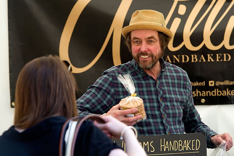a show visitor buying biscuits