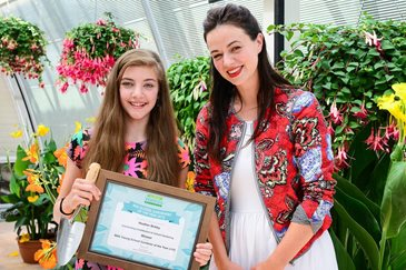 RHS Young School Gardener of the Year 2015 Heather Birkby receives her award from Frances Tophill