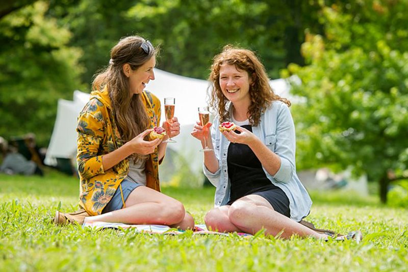 Ladies enjoying a snack with a glass of fizzy
