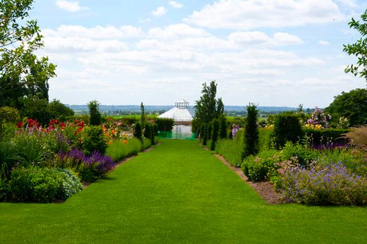 Flower beds with the glasshouse in the distance