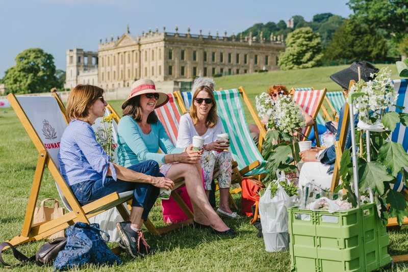 Visitors relax in deck chairs
