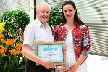 School Gardening Champion Peter Edwards receives his award from France Tophill